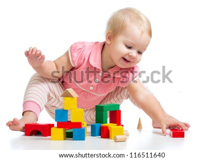 Happy kid playing toy blocks  isolated on white background - stock photo