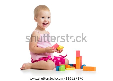 Happy kid playing toy blocks isolated on white background - stock photo