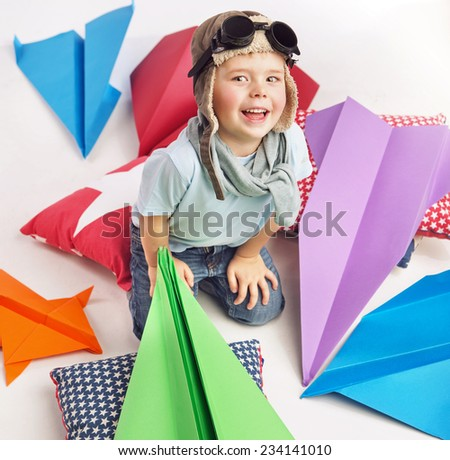 Happy kid playing with paper airplane