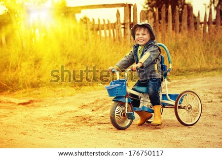 Happy kid riding a bike outdoors.