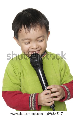 Happy Kid singing, with black microphone ,isolated