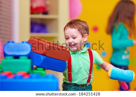 happy kid smashing toys in kindergarten - stock photo