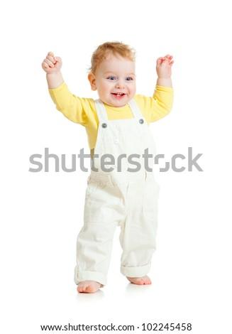 happy kid walking on white - stock photo