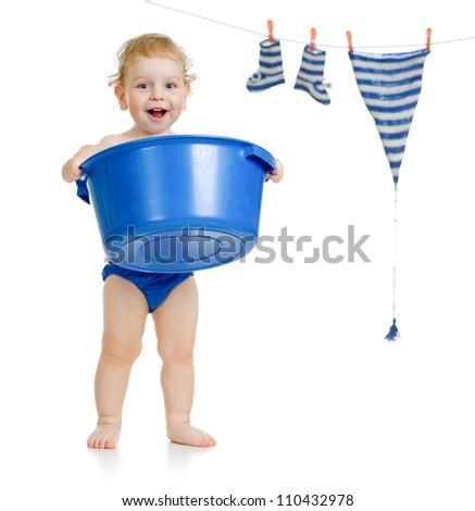 Happy kid washing his accessories - stock photo