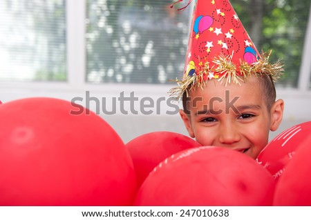 Happy kid with balloons - stock photo