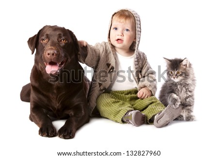 Happy kid with his pets - a dog and a kitten - stock photo