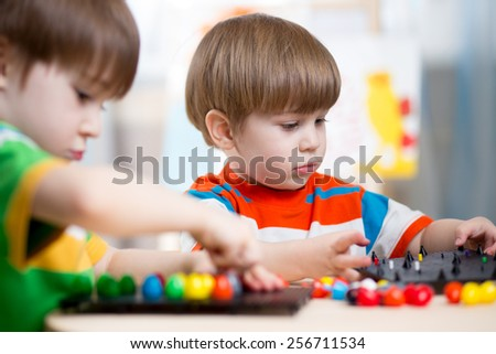 happy kids brothers play toys at home - stock photo