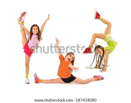 Happy kids doing exercises - stock photo