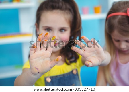Happy kids enjoying arts and crafts together using paints - stock photo