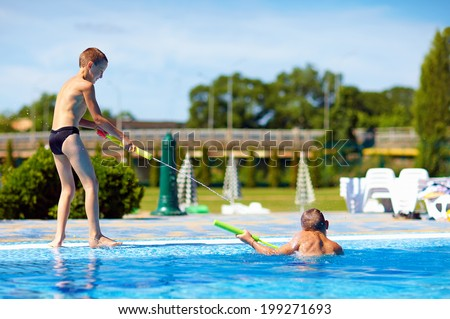 happy kids having fun, playing in water park