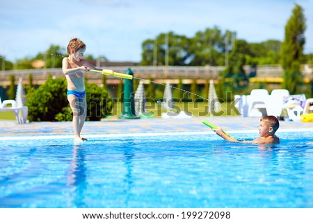 happy kids having fun, playing in water park - stock photo