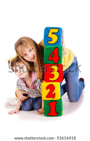Happy kids holding blocks with numbers over white background - stock photo