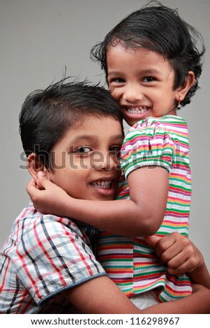Happy kids hugging each other