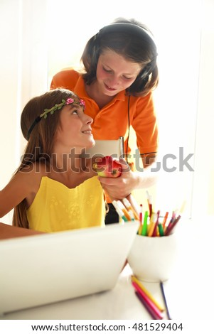 happy kids in school with a laptop