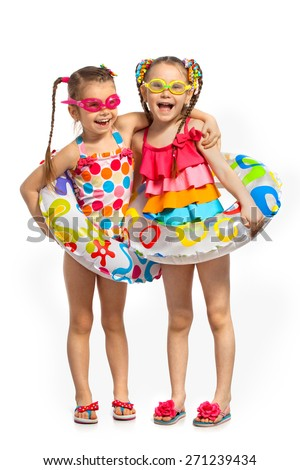 Happy kids in swimsuit and inflatable rings. Isolated on white background. Summer, fashionable, friendship concept. - stock photo