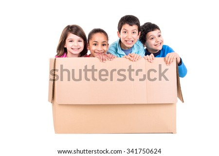 Happy kids inside a cardboard box isolated in white - stock photo