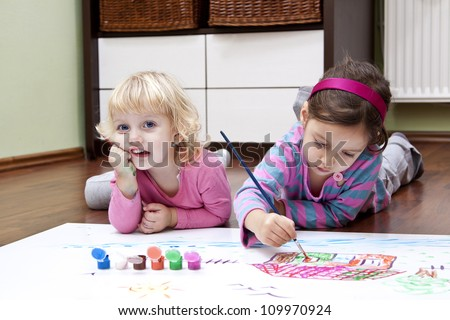 happy kids making a color picture - stock photo