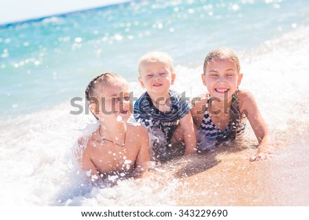 Happy kids on the beach having fun