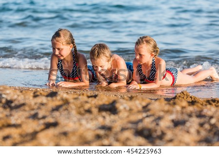 Happy kids on the beach having fun. Summer holiday concept