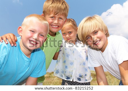 happy kids outdoor looking at camera in summertime - stock photo