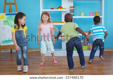 Happy kids playing games together in the bedroom - stock photo