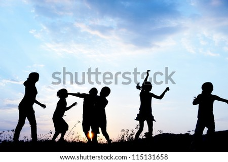 Happy kids playing on hot summertime - stock photo