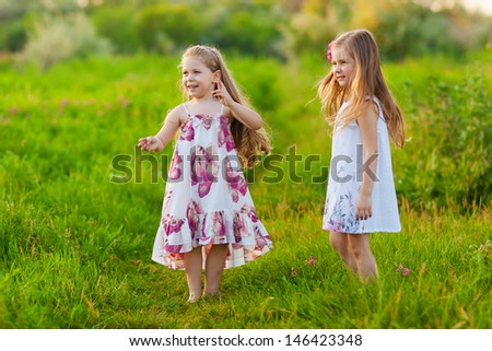 happy kids playing on the lawn - stock photo