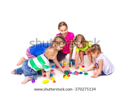 Happy kids playing with building blocks isolated on white. Team work, creativity concept. - stock photo