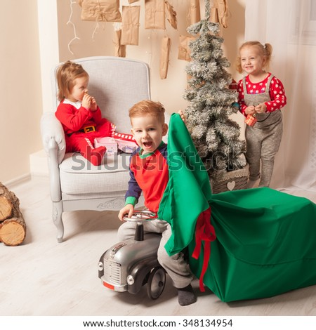 Happy kids preparing for Christmas - stock photo