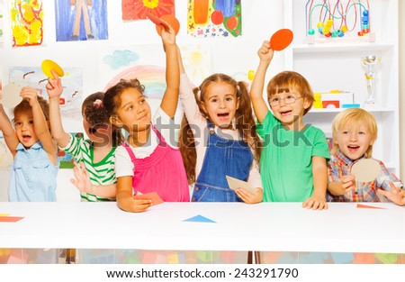 Happy kids showing cardboard shapes - stock photo