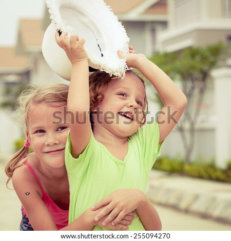 Happy kids sitting on the road. Concept Brother And Sister Together Forever - stock photo