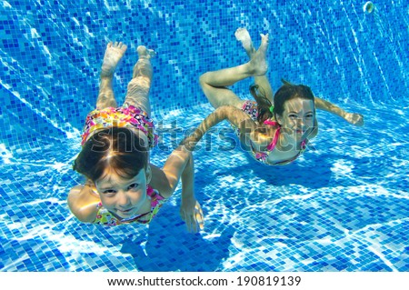 Kids Swimming Underwater happy kids swim underwater pool having stock photo 190819139