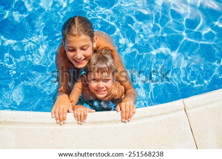 Happy kids swimming and snorking in the swimming pool - stock photo