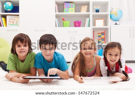 Happy kids using tablet computers - stock photo