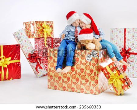 Happy kids wearing Santa caps - stock photo