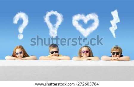 Happy kids wearing sunglasses - stock photo
