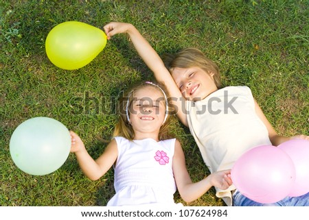 happy kids with balloons - stock photo