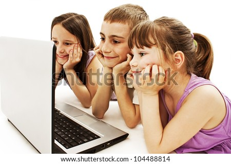 Happy kids with laptop computer. Isolated on white background. - stock photo