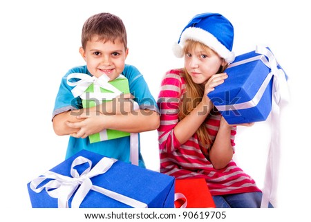 Happy kids with present boxes isolated on white - stock photo