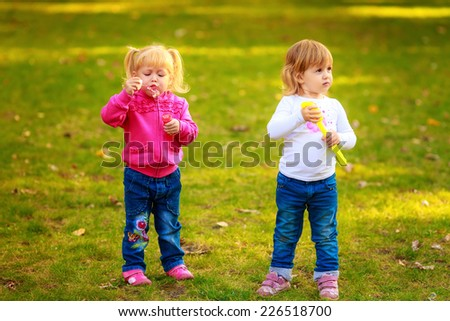 Happy kids with soap bubbles in the park. play, run, active,   children's emotions - stock photo