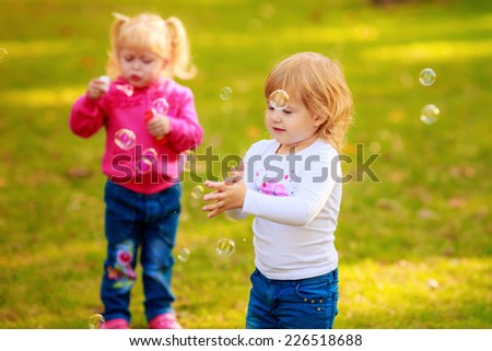 Happy kids with soap bubbles in the park. play, run, active, relaxing, fun, children's emotions - stock photo