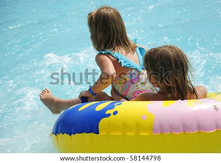 Happy kids with water adventure - stock photo