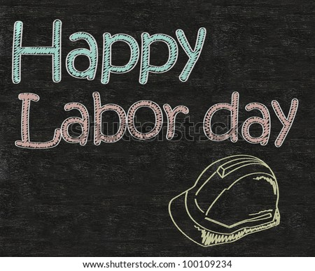 happy Labor day, may day with safety helmet written on blackboard background high resolution - stock photo