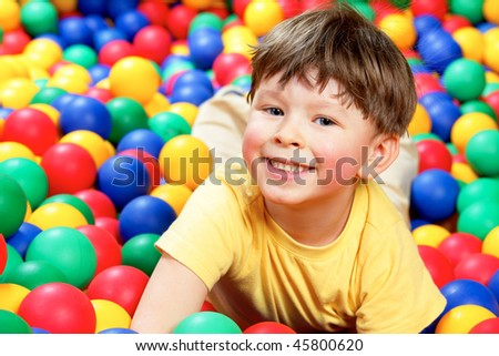 Happy lad looking at camera during play - stock photo
