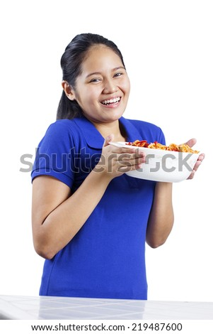 Happy lady holding a bowl of spaghetti. Isolated in white background. - stock photo