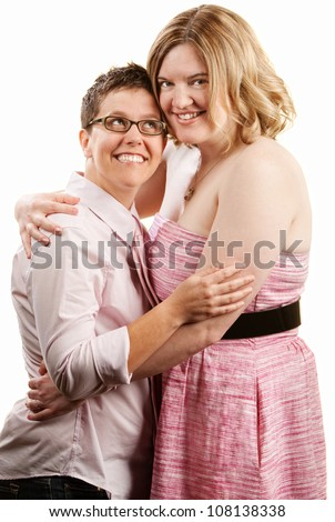 Happy lady looks up to her female companion - stock photo