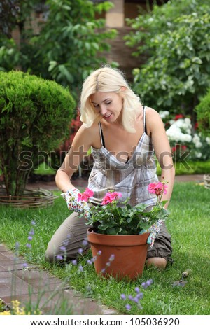 Happy lady working in the garden. - stock photo
