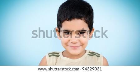 Happy latin boy smiling to the camera - stock photo