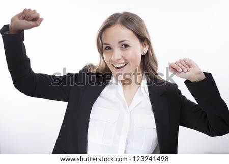Happy latin business woman celebrating her success - stock photo