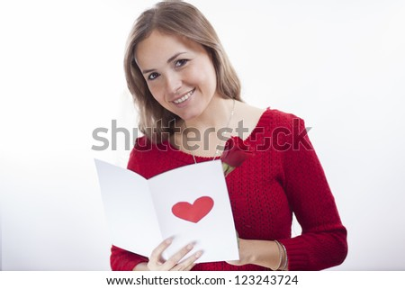 Happy latin girl getting gifts on valentine's day - stock photo
